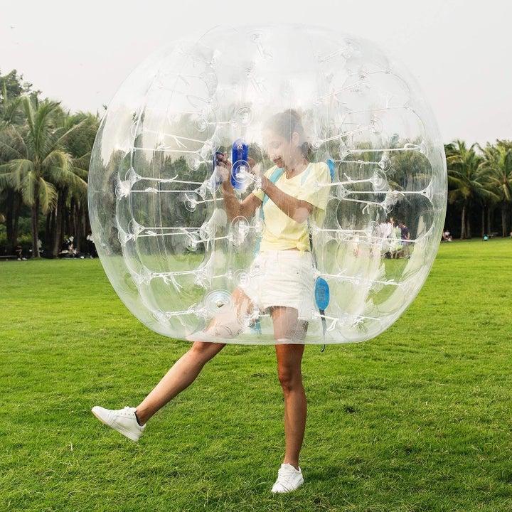 a model inside a clear zorb ball