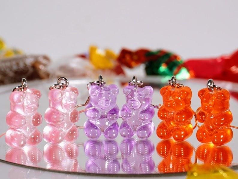 The gummy bear-shaped drop earrings in pink, purple, and orange