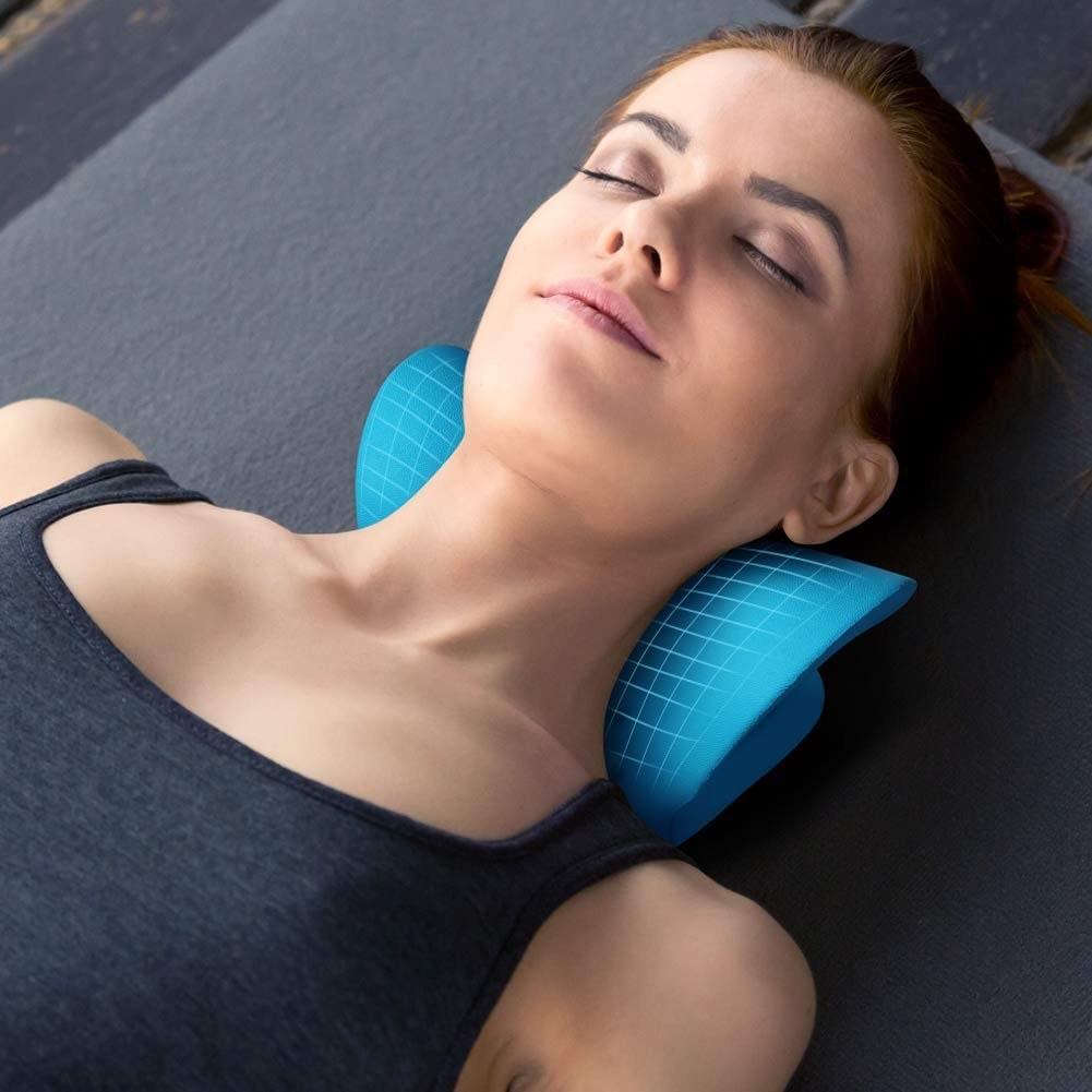 A person laying on the cervical traction tool