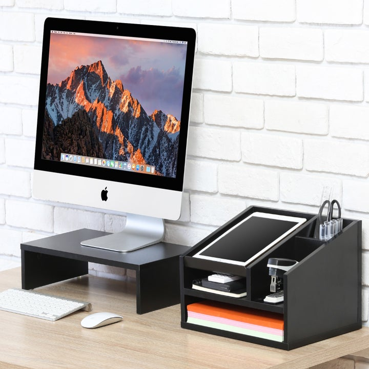 the desk supply organizer with an ipad and supplies in it