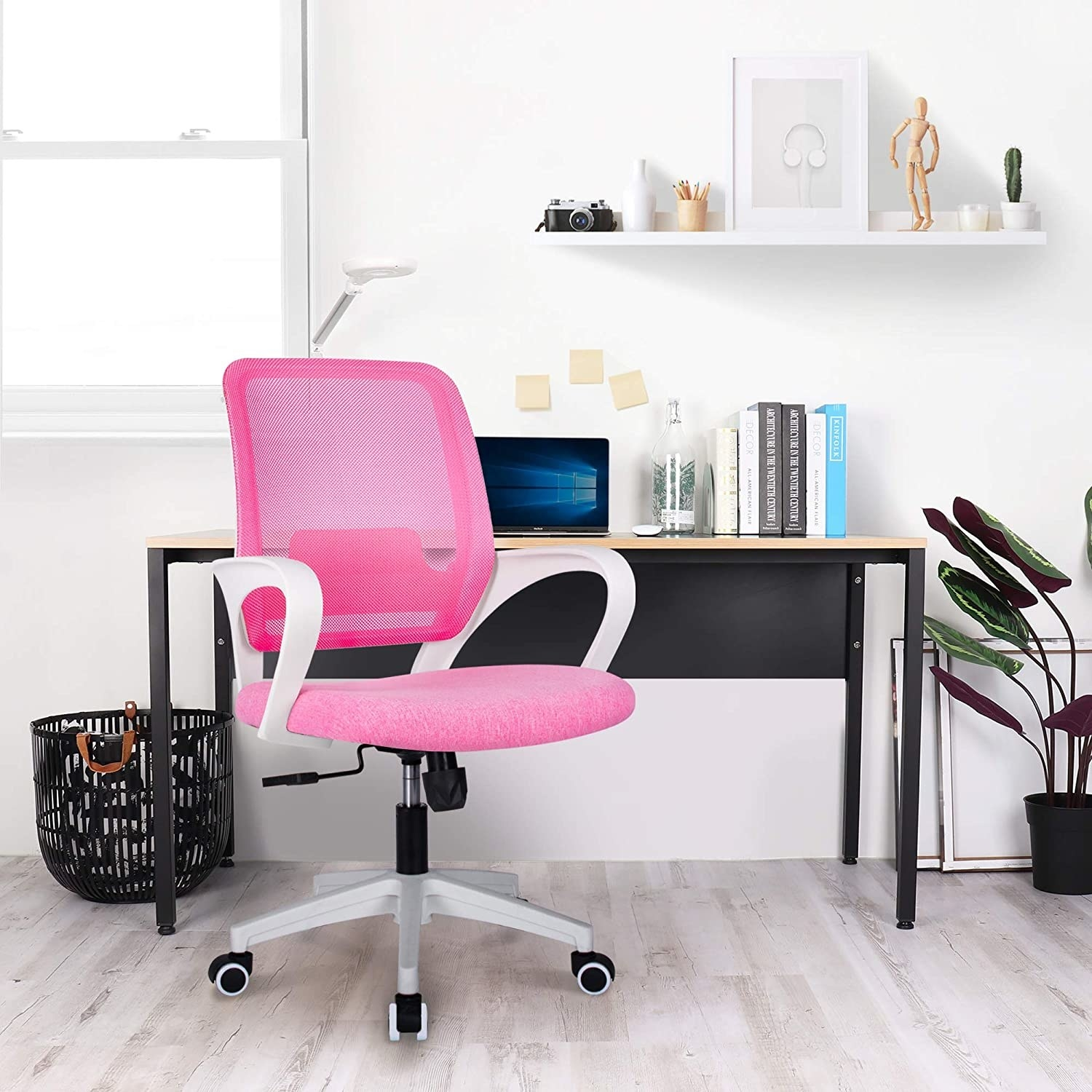 office chair with hot pink mesh back and hot pink cushioned seat, and white armrests and base