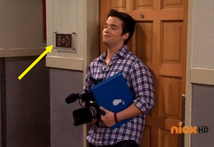 """Freddie from """"iCarly"""" standing in front of his apartment door and the apartment number is """"8=D"""" as if to look like a penis."""