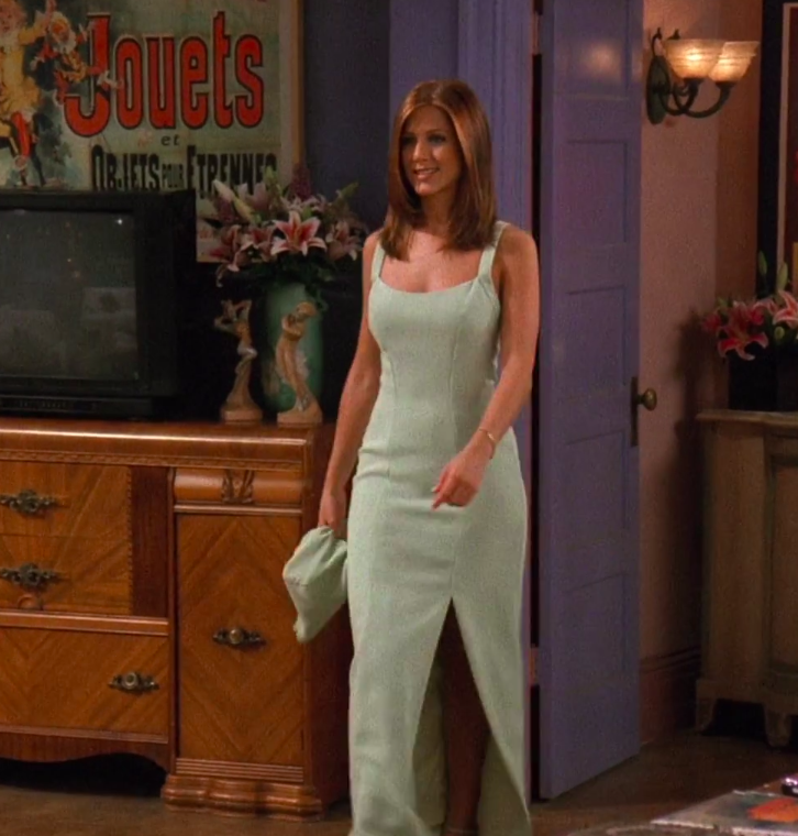 Rachel wearing a light gown with a slit
