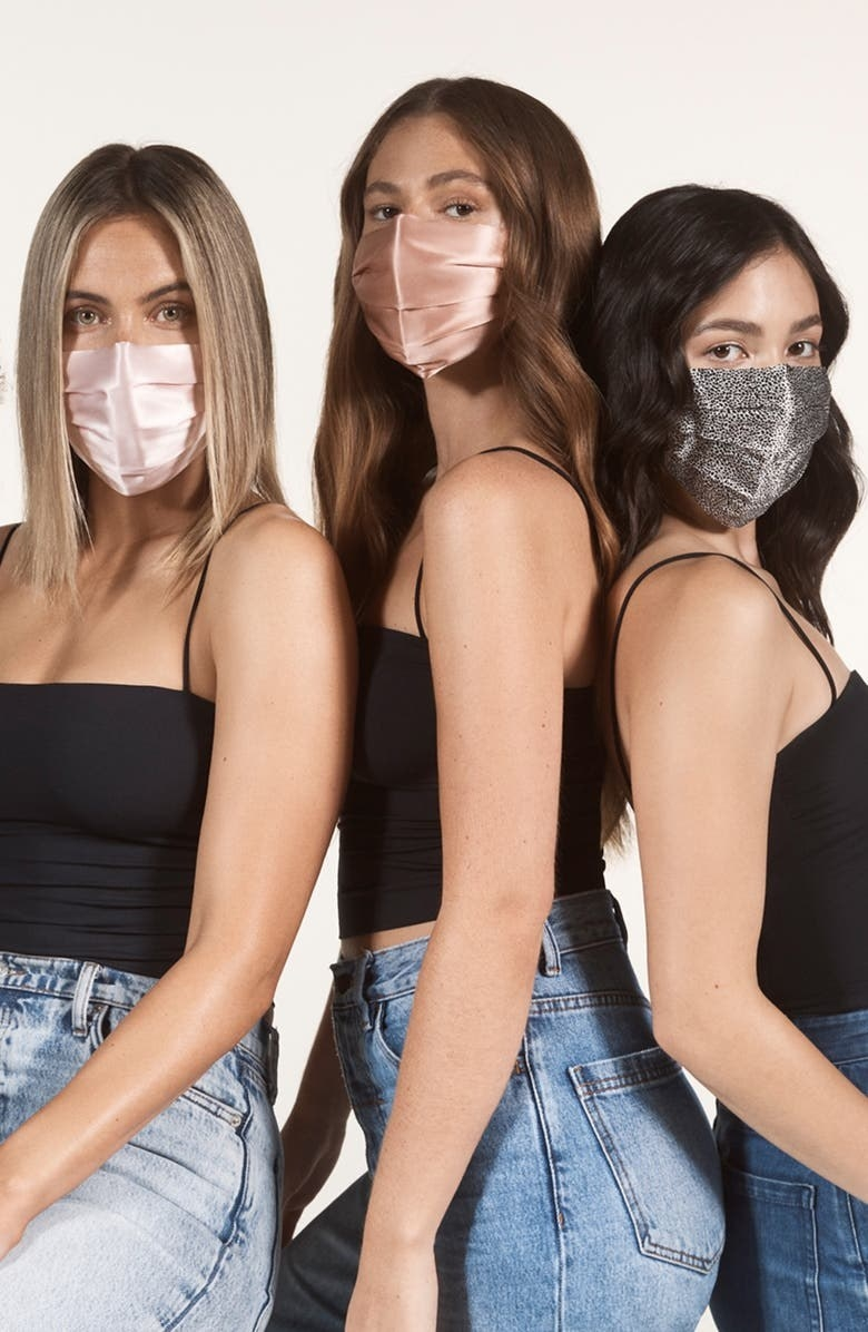 Three models wearing the face covering in different colors