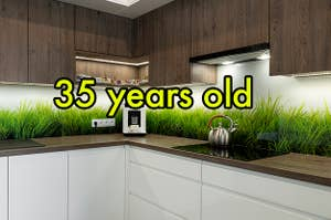 An image of a backsplash with grass growing behind it with