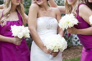 A group of bridesmaids posing with a bride