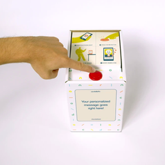 a hand pressing the red button that opens the balloon