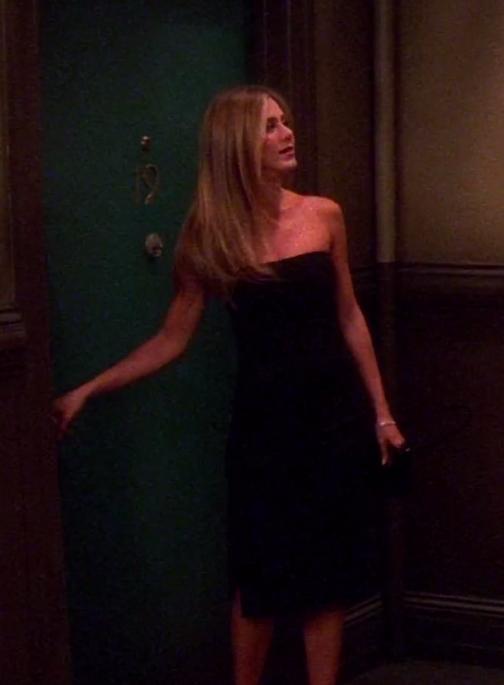 Rachel wearing a strapless midi dress