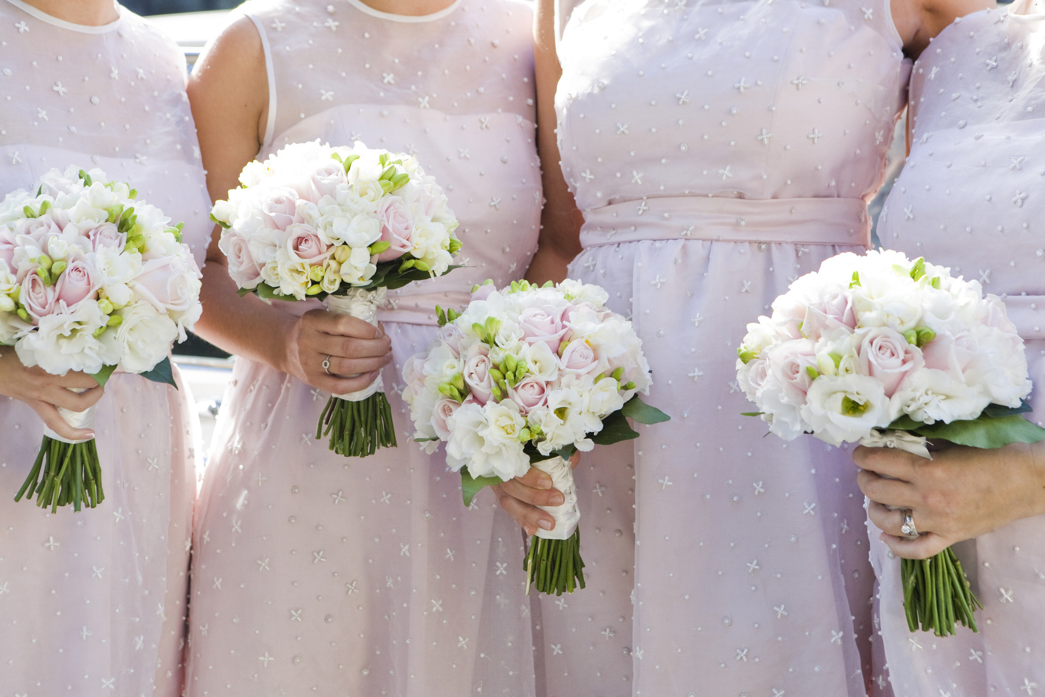 A group of bridesmaids pose in matching dresses