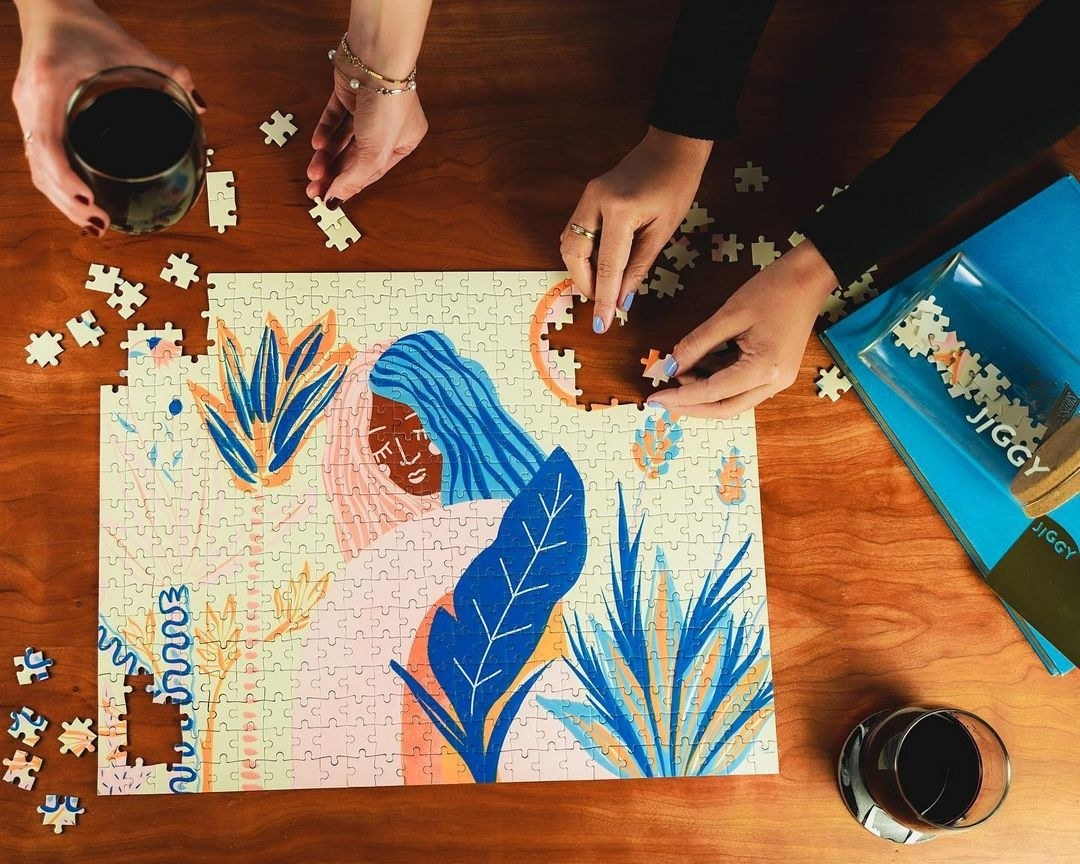 Two people completing a puzzle