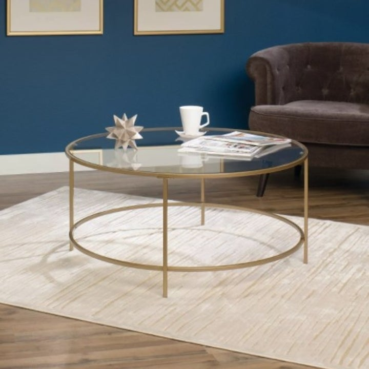 Glass circle table with a gold finish
