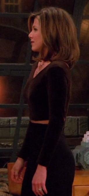 Rachel wearing a long-sleeve crop top and high-waisted pants
