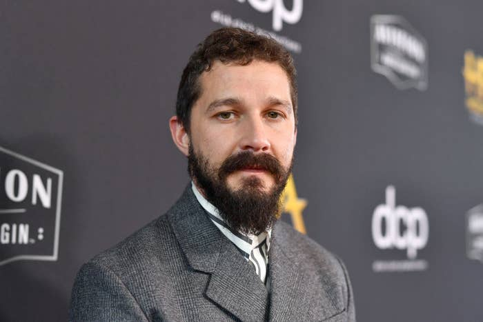Shia LaBeouf wearing a suit on the red carpet