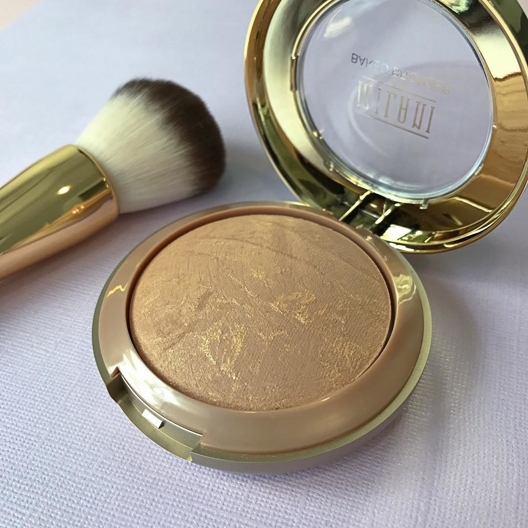 The gold bronzer and a brush