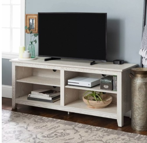 The weathered wood TV stand in the color white wash