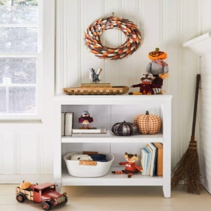 The bookcase in the color white in a house