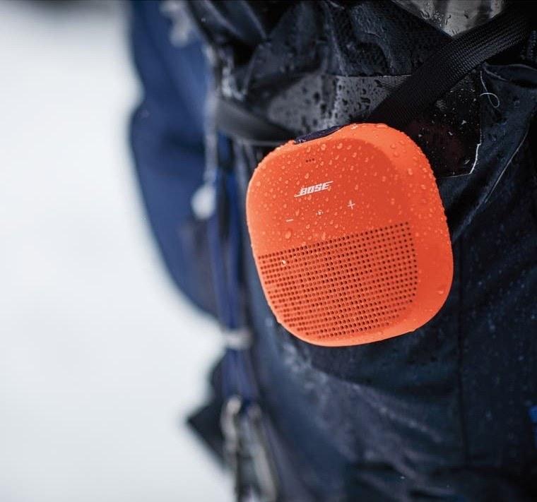 The speaker in orange being taken out in the rain