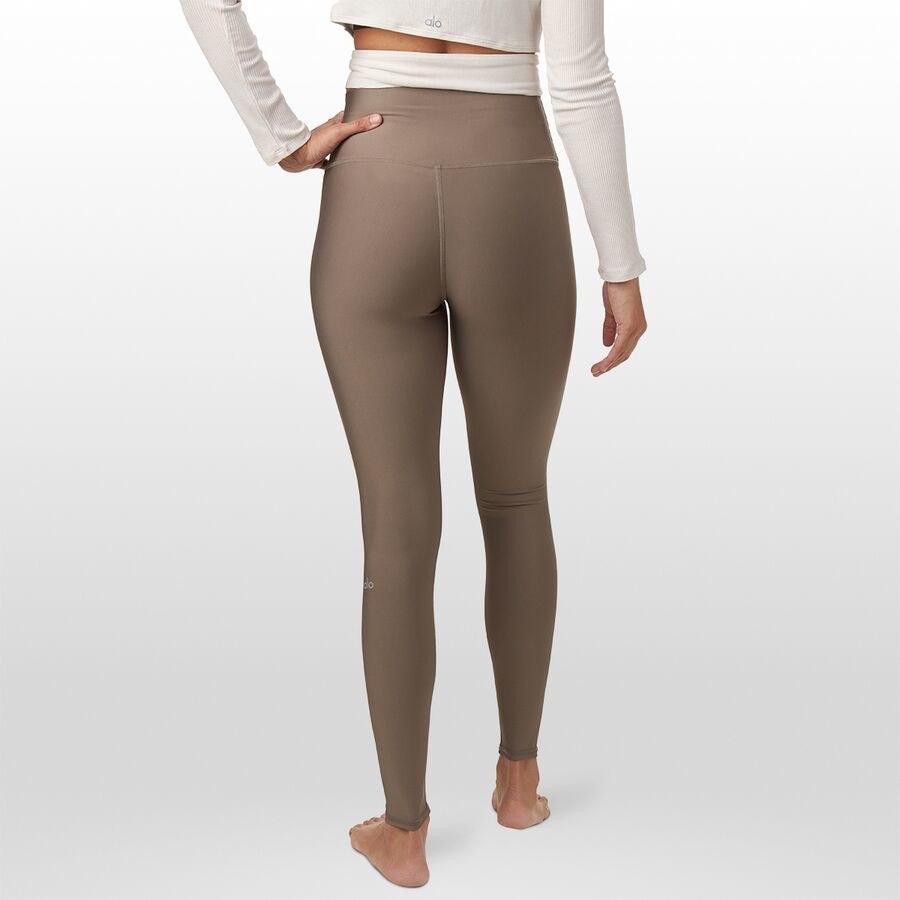 Model wearing the leggings in tan