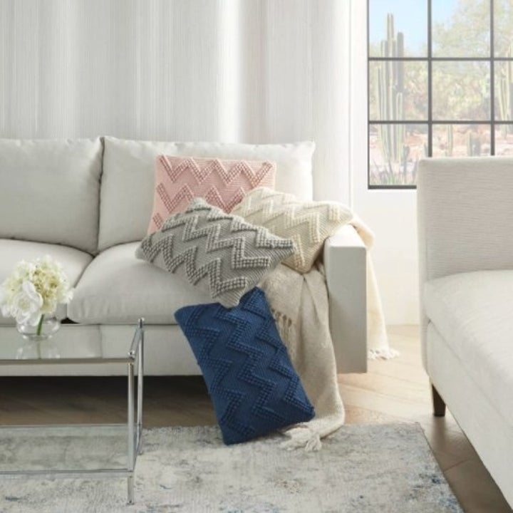 The chevron lumbar pillows in blush, ivory, light gray, and indigo