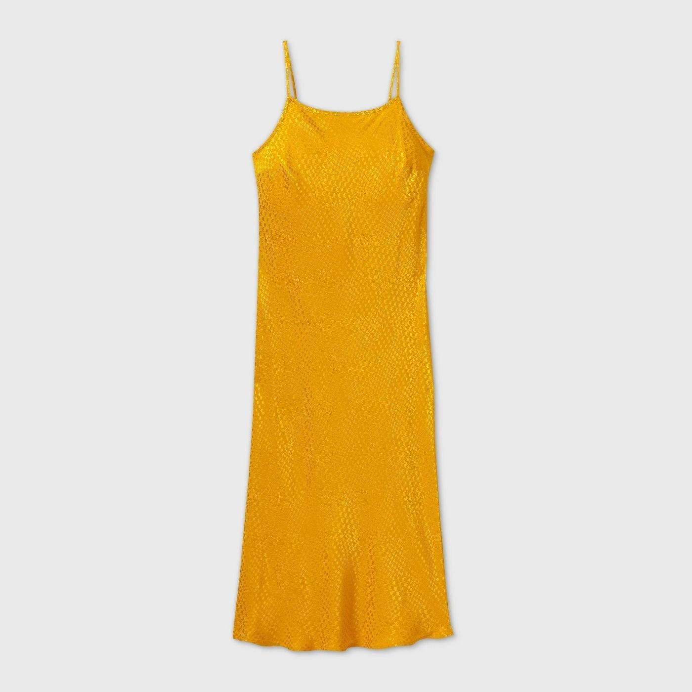 A yellow slip dress