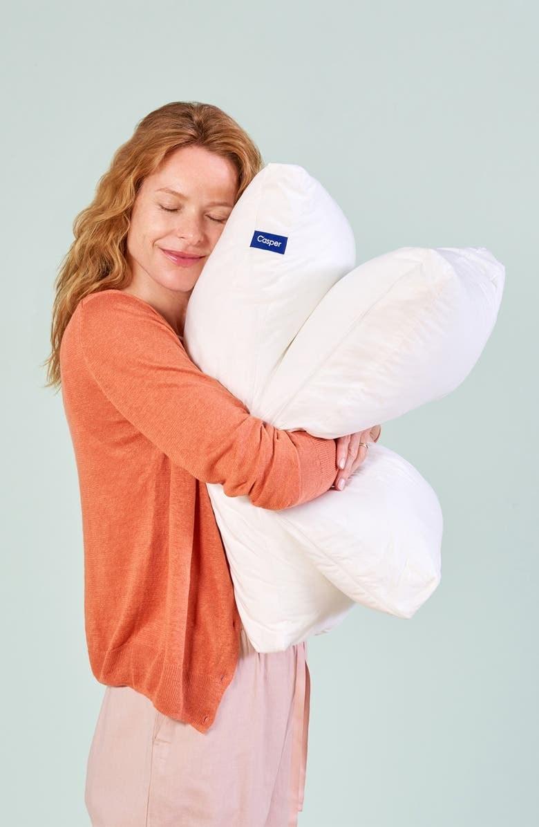 A person hugging to Casper pillows