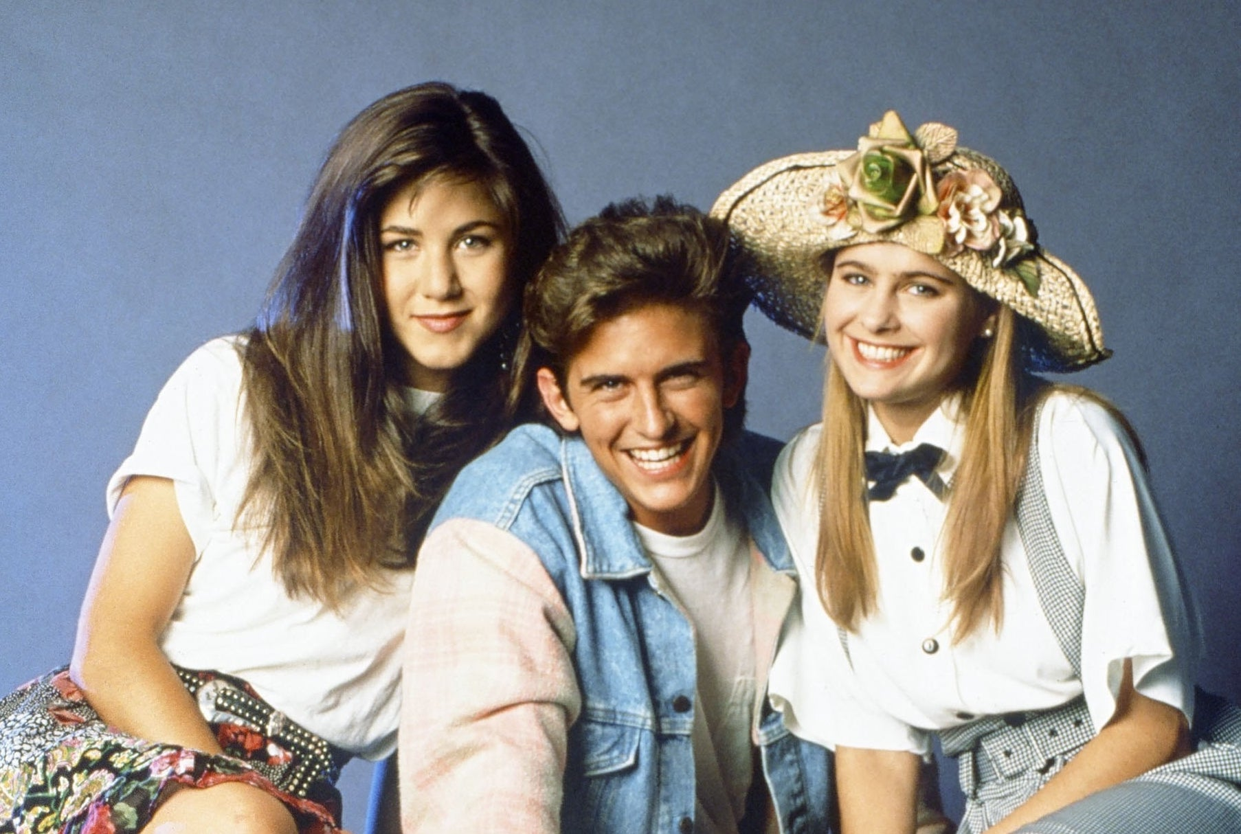 Jennifer Aniston as Jeannie Bueller, Charlie Schlatter as Ferris Bueller, Ami Dolenz as Sloan Peterson sitting on a white limo