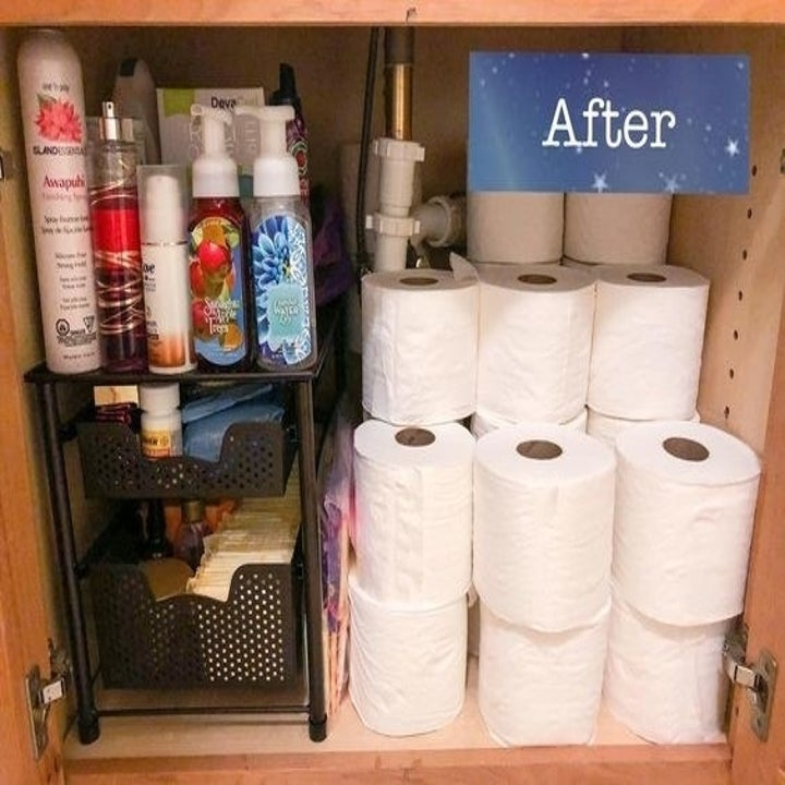 A reviewer's organized, clean under sink area with the drawers