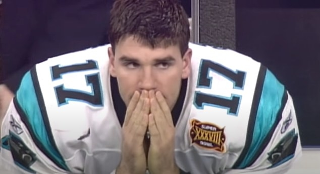 Jake Delhomme covering mouth.