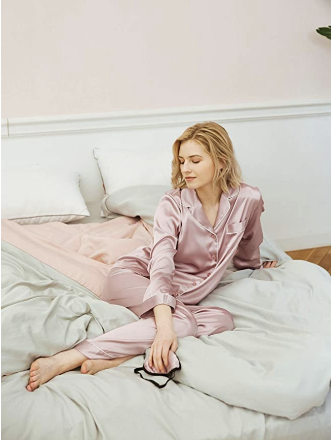person lying in bed with the pyjama set on