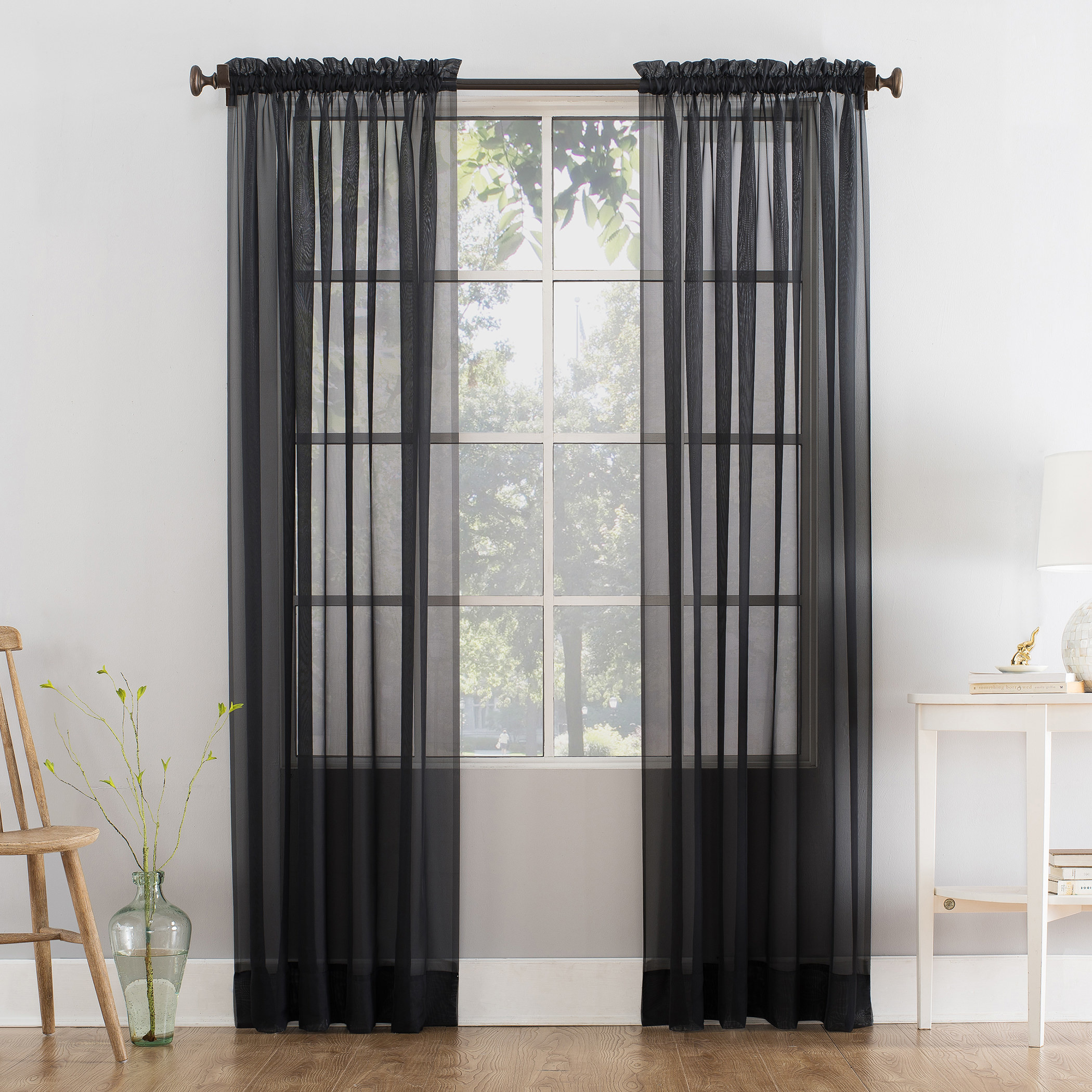 The curtains, which are sheer, in black