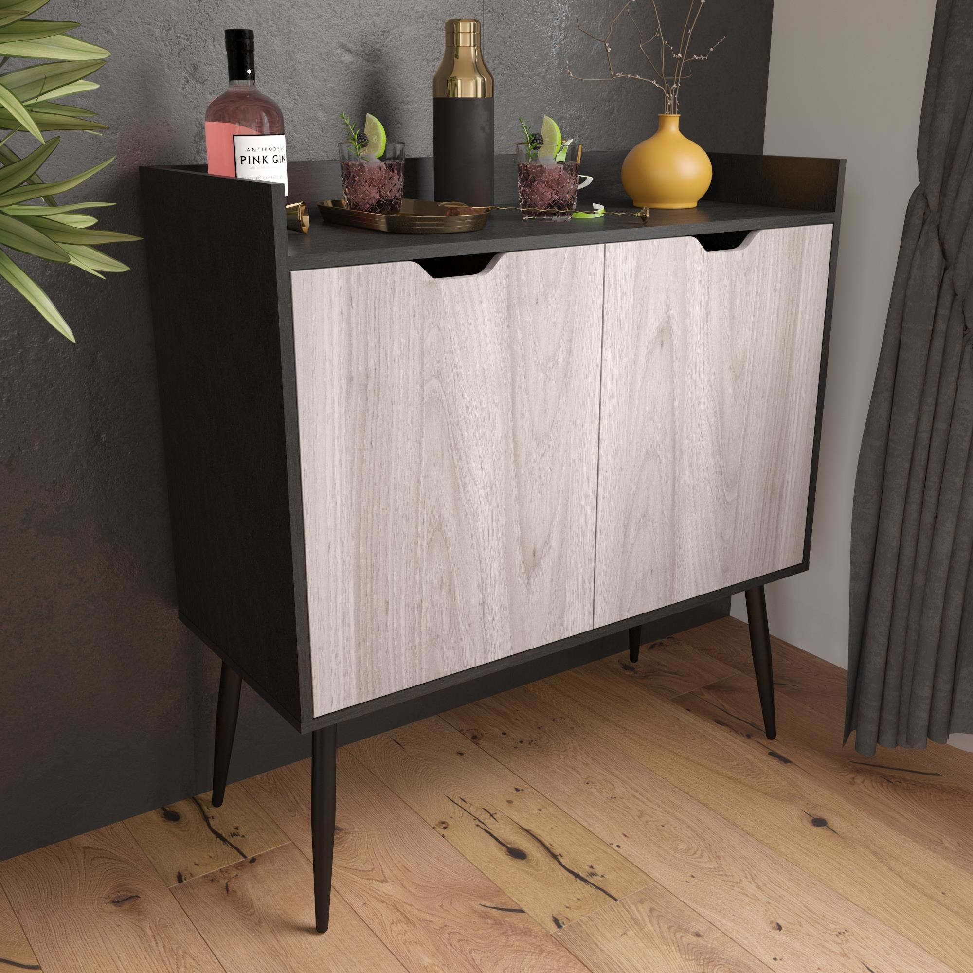 The cabinet, which has two hinged doors that are a light oak color, and a dark body, top, and legs