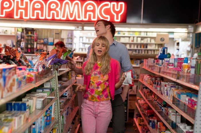 Carey Mulligan and Bo Burnham dance in a pharmacy in a scene from Promising Young Woman