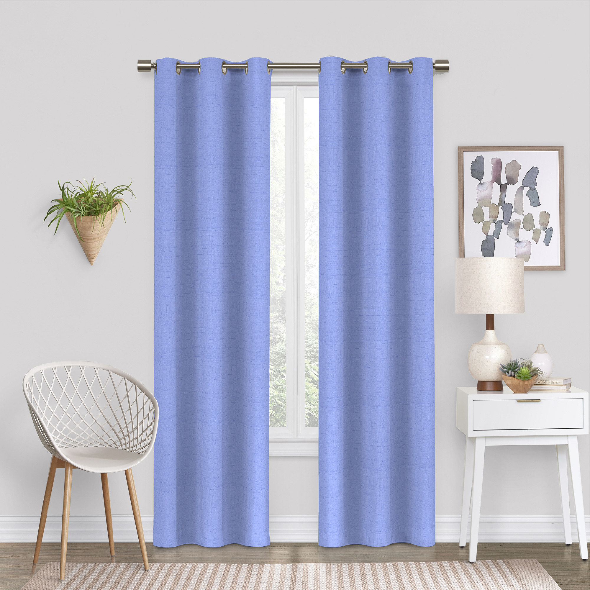 The curtains, which hang to the floor, in periwinkle