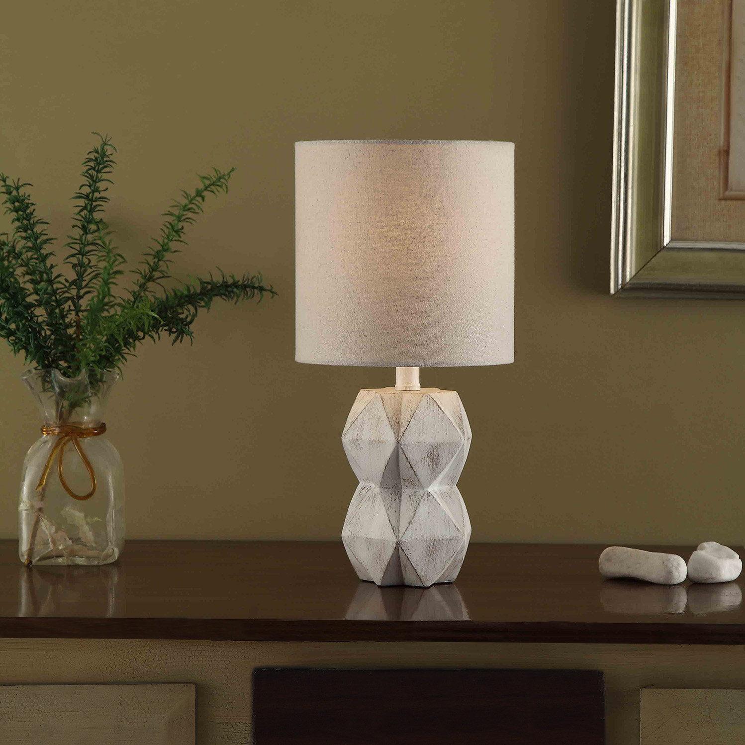 The lamp, which has geometric facets, in white