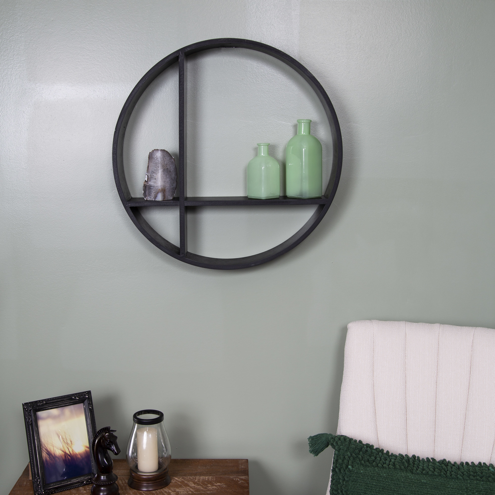 The shelf, which is round, and has a shelf across the width, as well as a divider along the length