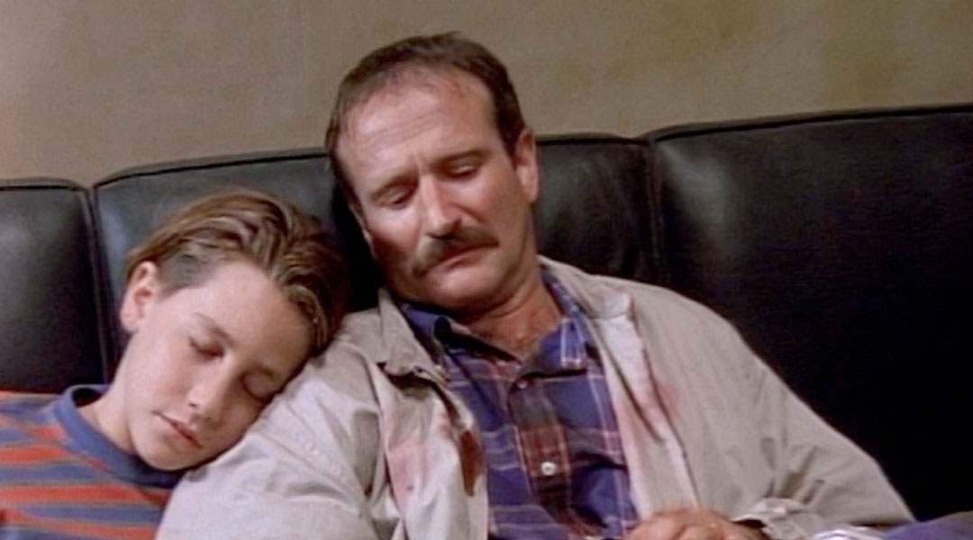 Screenshot of Jake sleeping on Robin Willams' shoulder
