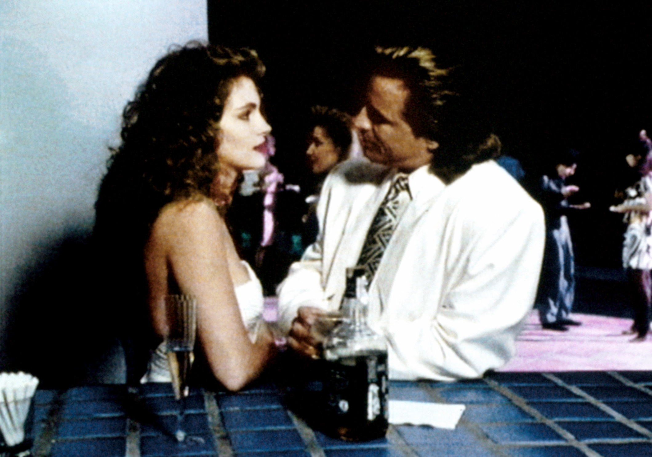 A photo of Julia Roberts talking Don Johnson on the set of Miami Vice