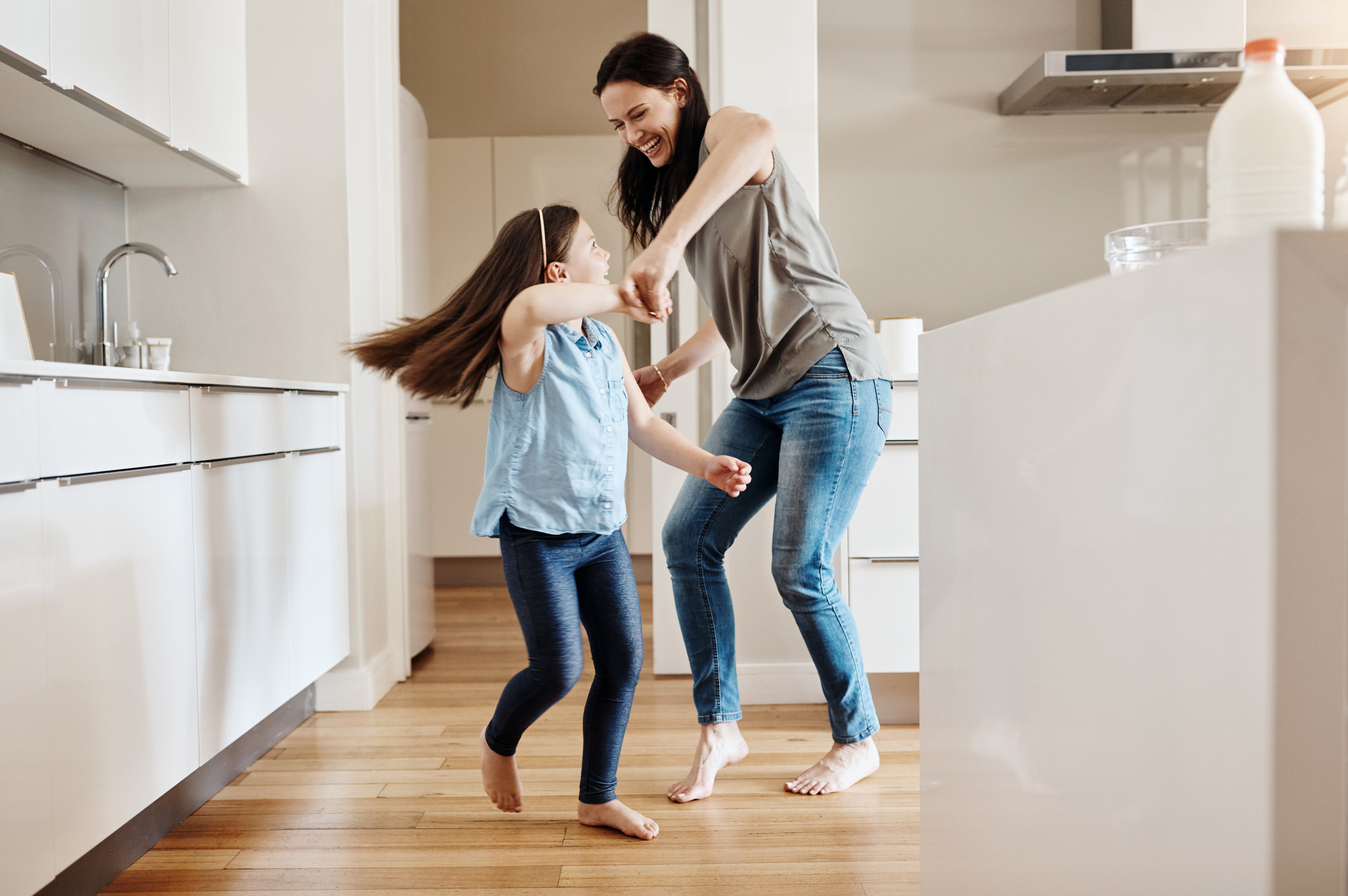 A mom dances with her daughter