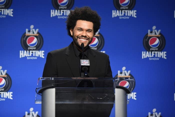 The Weeknd smiles at a Super Bowl Halftime Show press event