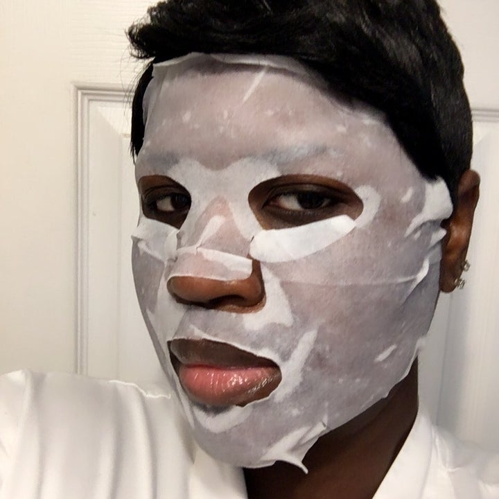 Another reviewer wearing the mask