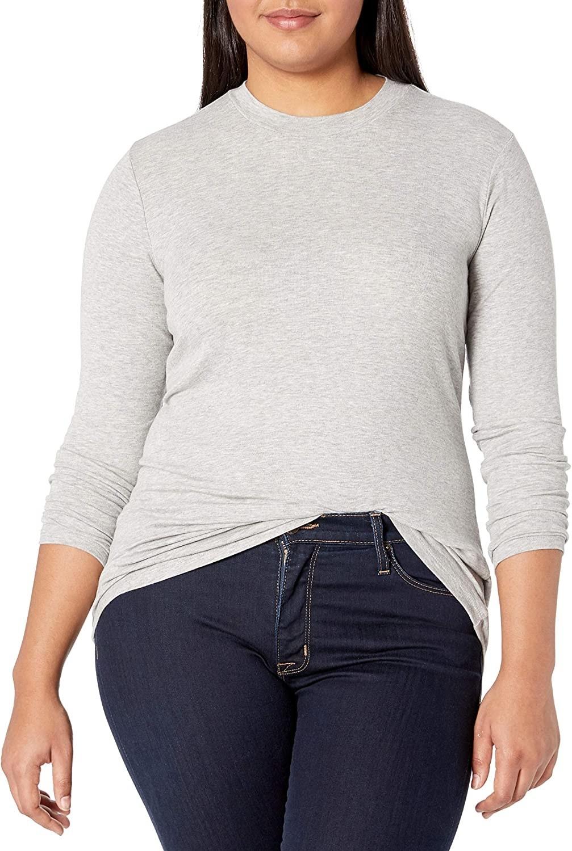 Model wearing the heather grey sweater