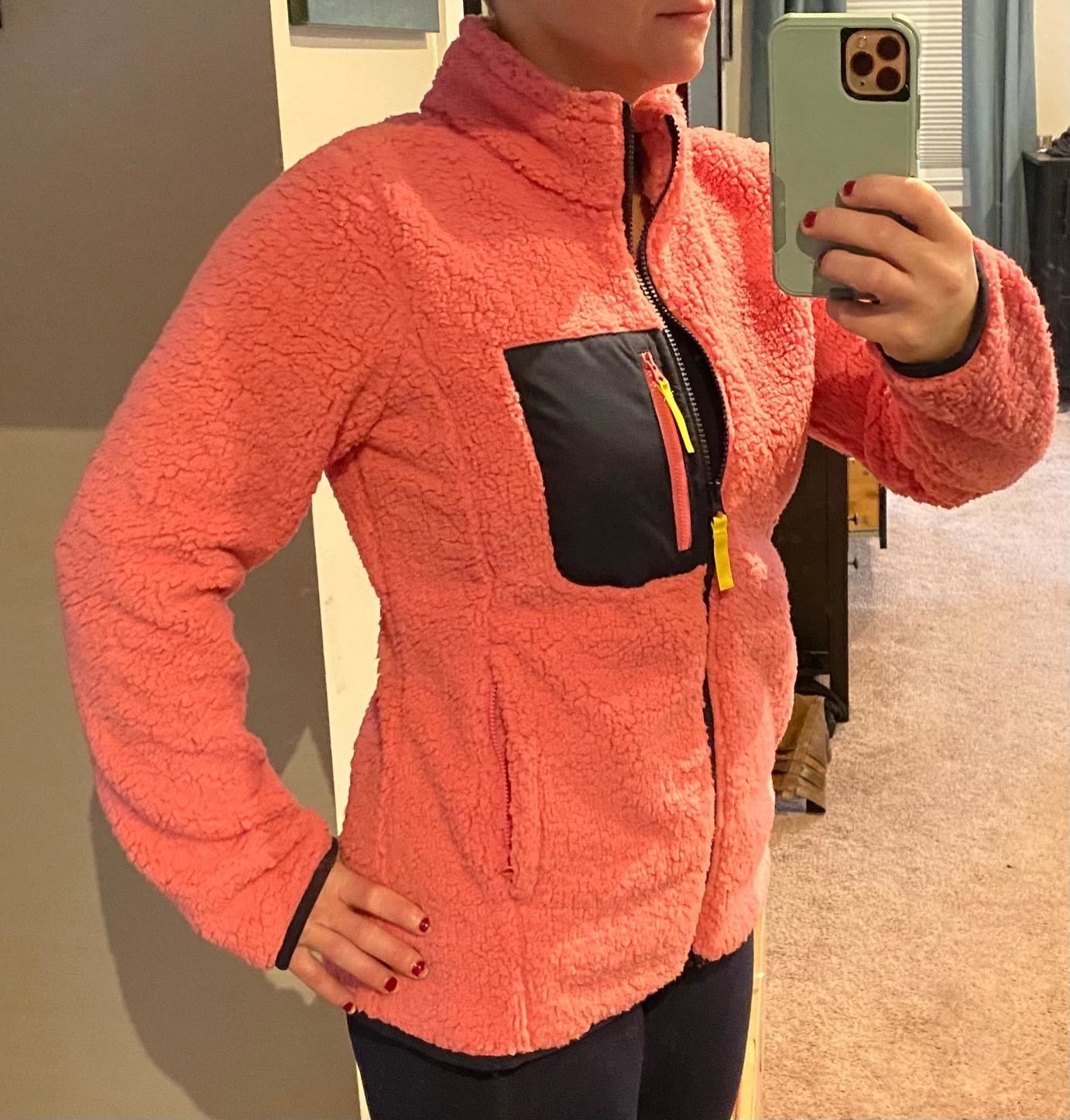 Reviewer wearing the pink/navy jacket