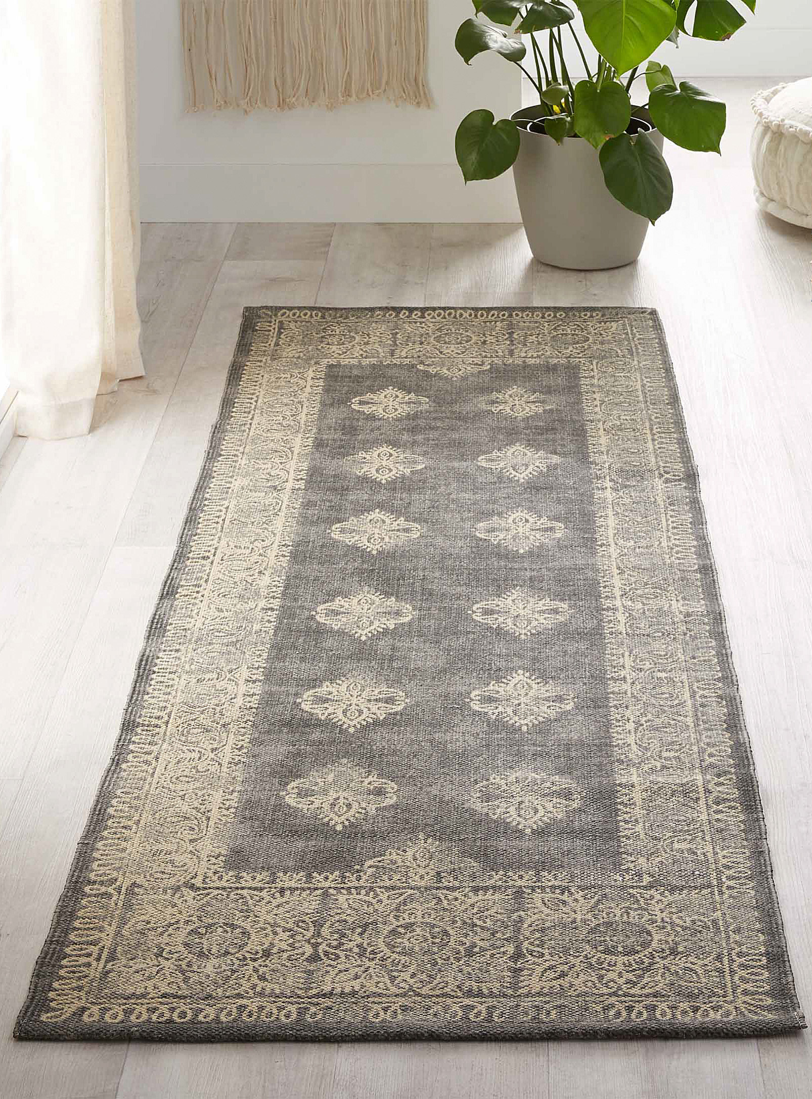 The carpet runner next to a plant