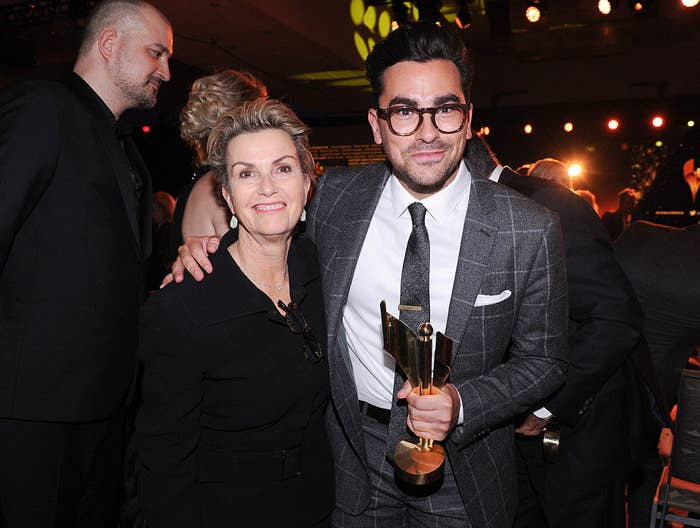 Dan and his mom while holding an award