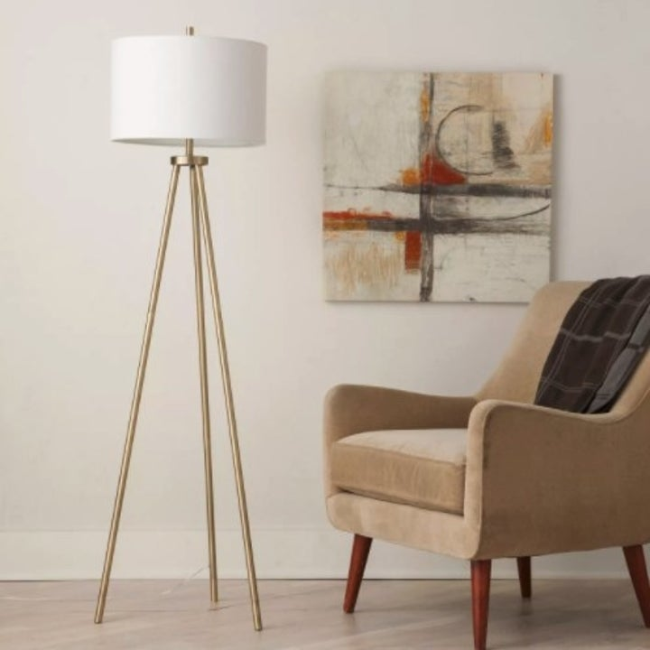 The brass tripod lamp in a living room
