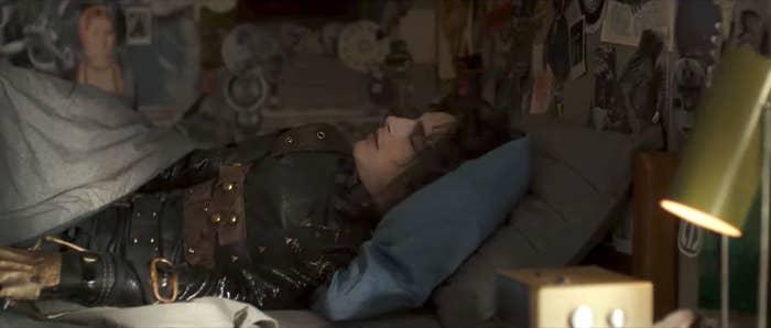 Timothee Chalamet as Edgar laying in bed