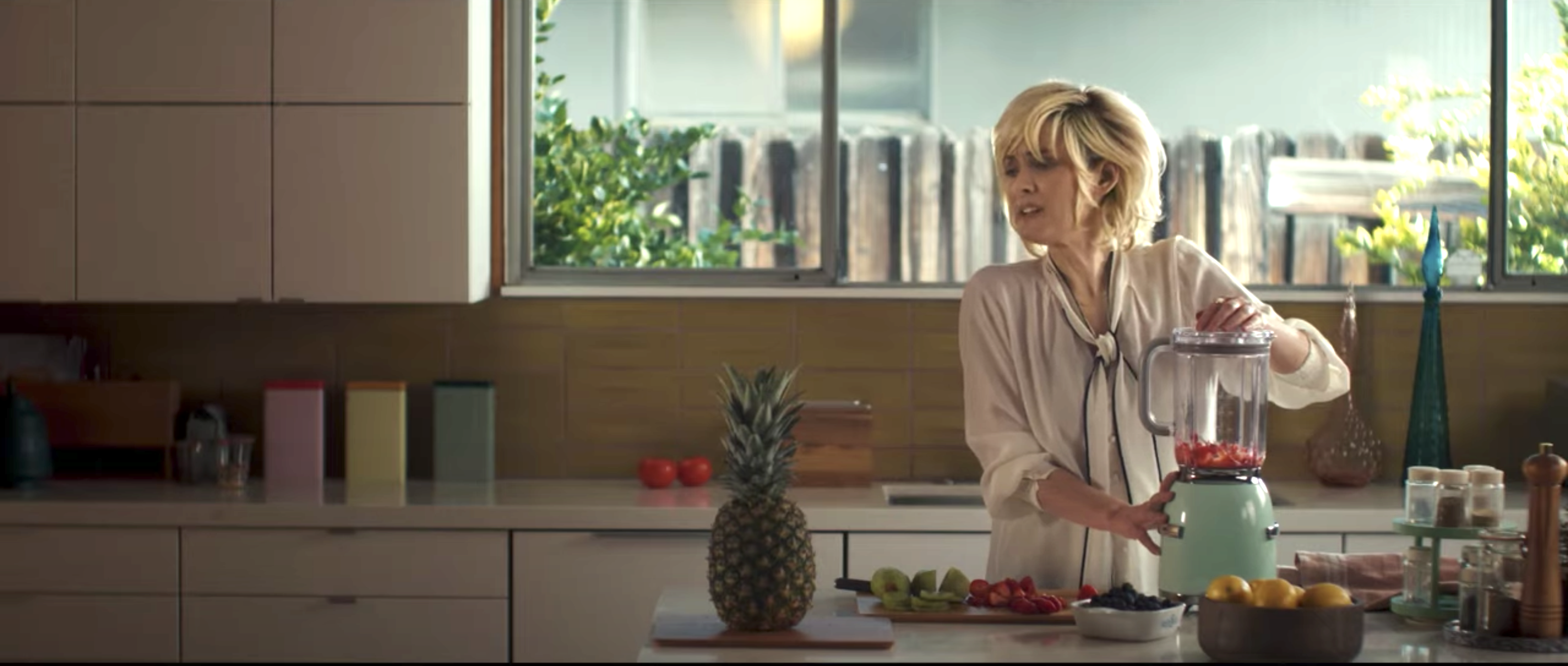 Winona as Momma Boggs placing fruit into a blender
