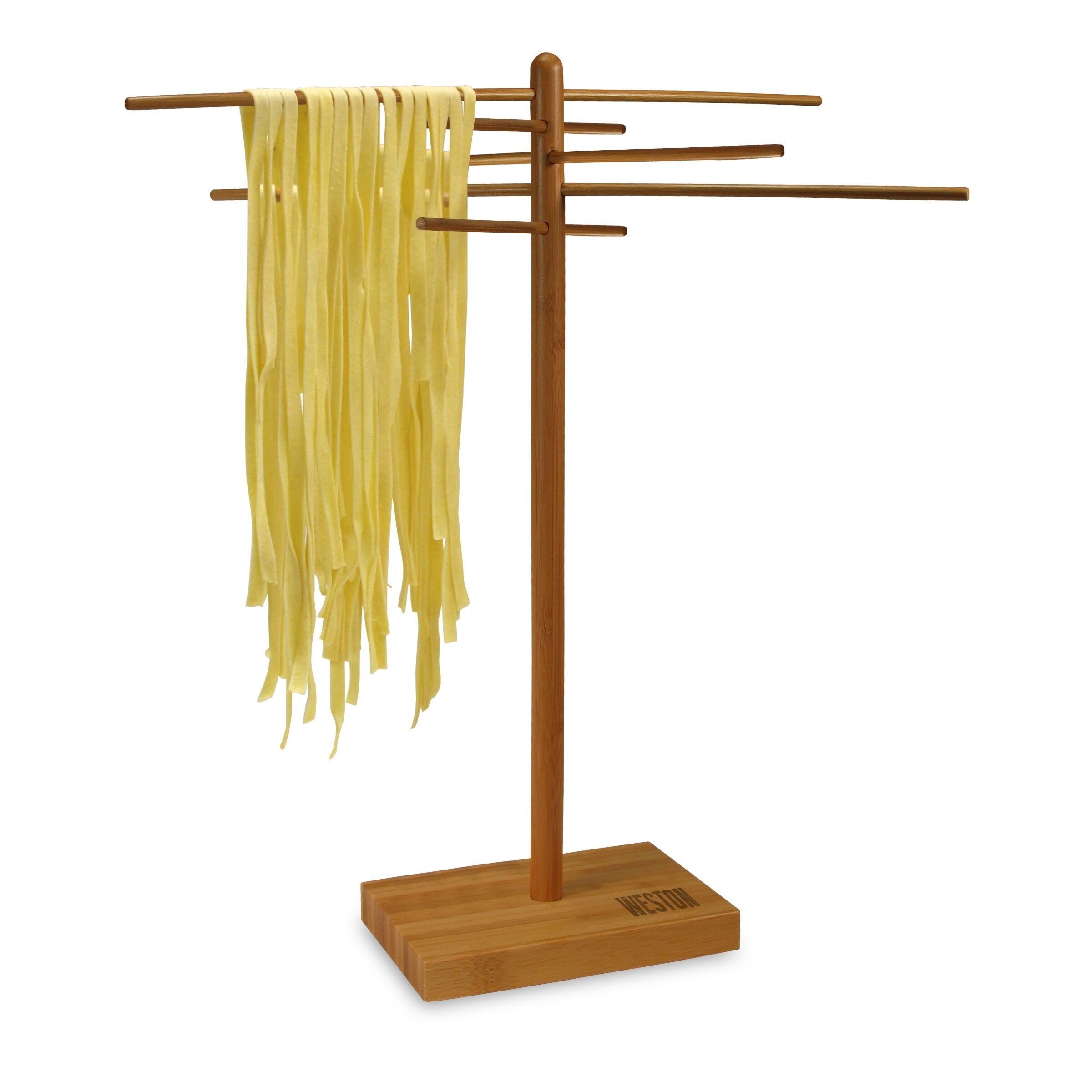 Fresh pasta hanging to dry on a bamboo rack