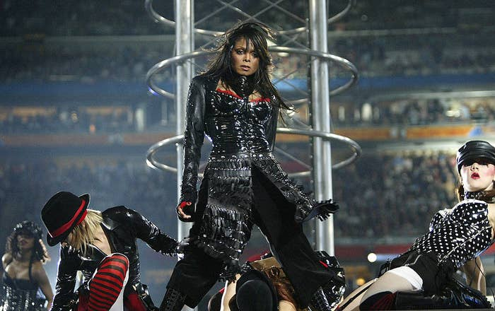 Janet Jackson flanked by dancers during her Super Bowl performance