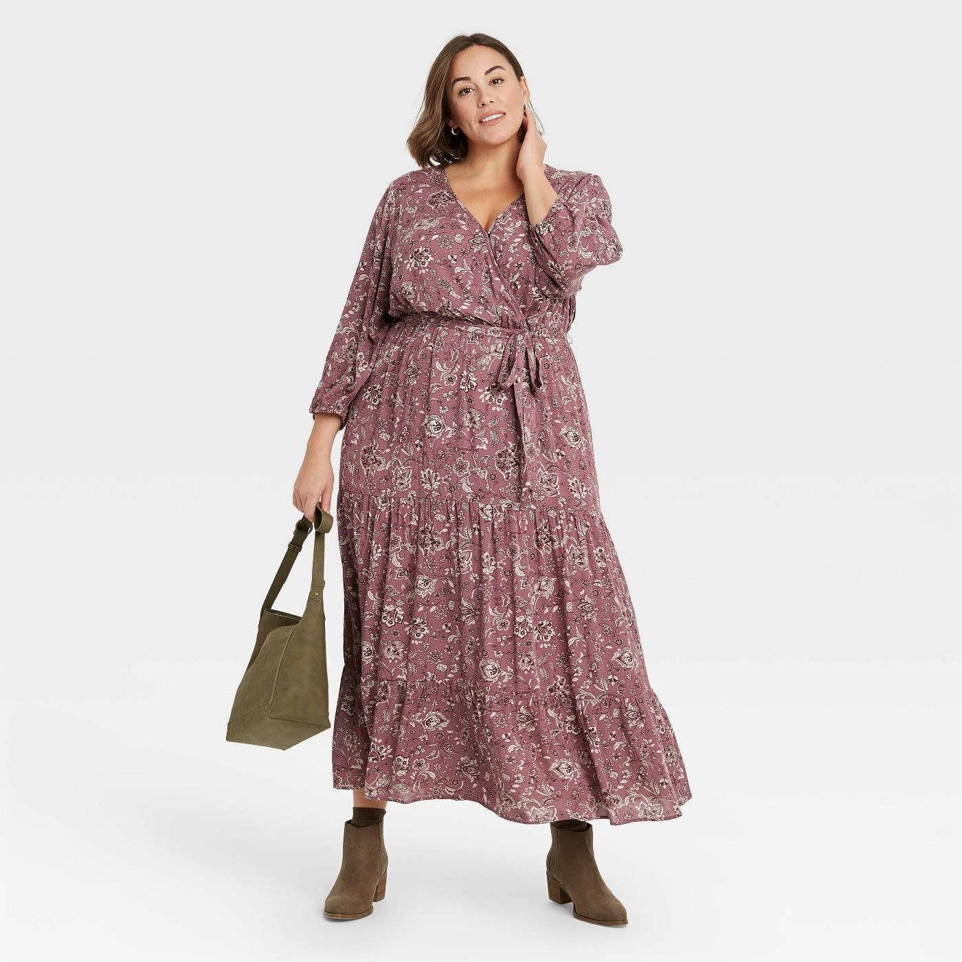Model wearing dark lavender floral dress with hints of brown and white